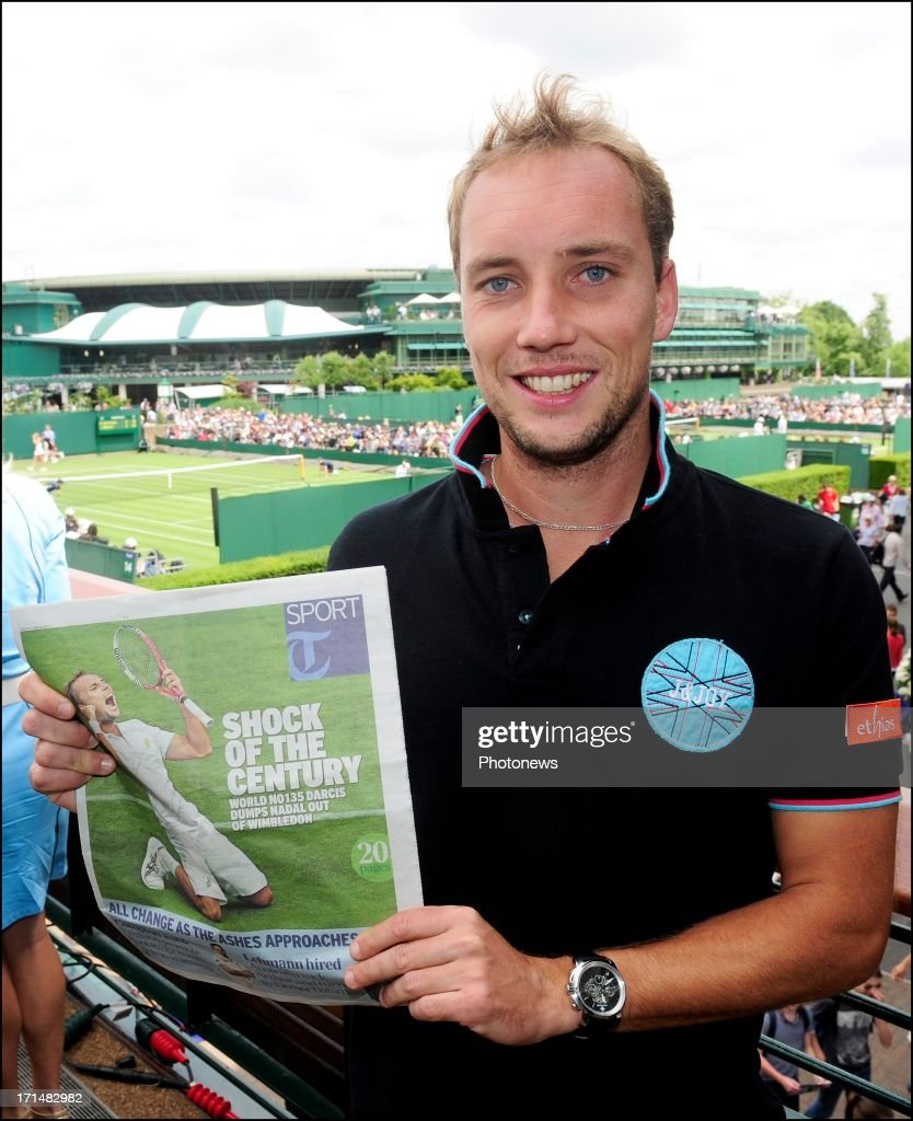 <a gi-track='captionPersonalityLinkClicked' href=/galleries/search?phrase=Steve+Darcis&family=editorial&specificpeople=4354952 ng-click='$event.stopPropagation()'>Steve Darcis</a> of Belgium (C) pictured with The Telegraph Sport newspaper, the day after his victory against Nadal on day one of Wimbledon on 25 June, 2013 in London, England.
