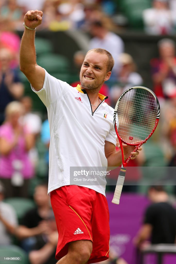 <a gi-track='captionPersonalityLinkClicked' href=/galleries/search?phrase=Steve+Darcis&family=editorial&specificpeople=4354952 ng-click='$event.stopPropagation()'>Steve Darcis</a> of Belgium reacts after beating Tomas Berdych of Czech Republic in their Men's Singles Tennis match on Day 1 of the London 2012 Olympic Games at the All England Lawn Tennis and Croquet Club in Wimbledon on July 28, 2012 in London, England.