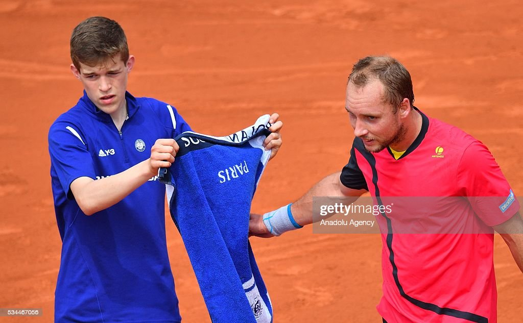 Steve Darcis (R) of Belgium reacts during the match against Novak Djokovic (not seen) of Serbia, during their men's single second round match at the French Open tennis tournament at Roland Garros in Paris, France on May 26, 2016.