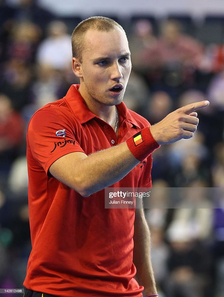 <a gi-track='captionPersonalityLinkClicked' href=/galleries/search?phrase=Steve+Darcis&family=editorial&specificpeople=4354952 ng-click='$event.stopPropagation()'>Steve Darcis</a> of Belgium reacts in his match against Joshua Goodall of Great Britain during day one of the Davis Cup match between Great Britain and Belgium at the Braehead Arena on April 6, 2012 in Glasgow, Scotland.