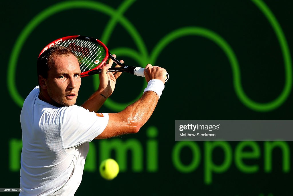 <a gi-track='captionPersonalityLinkClicked' href=/galleries/search?phrase=Steve+Darcis&family=editorial&specificpeople=4354952 ng-click='$event.stopPropagation()'>Steve Darcis</a> of Belgium returns a shot to Novak Djokovic of Serbia during day 8 of the Miami Open Presented by Itau at Crandon Park Tennis Center on March 30, 2015 in Key Biscayne, Florida.
