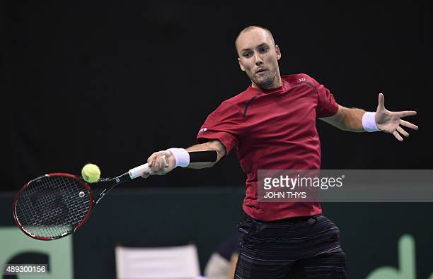 Steve Darcis of Belgium returns the ball during his Davis Cup semifinal tennis match against Federico Delbonis of Argentinia at the Forest National...