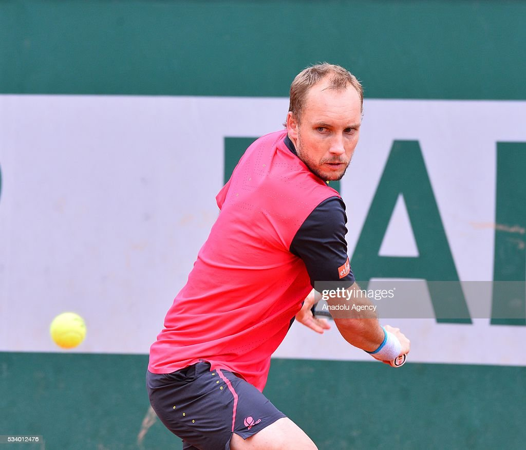 Steve Darcis of Belgium returns the ball to Marsel Ilhan of Turkey during their men's single first round match at the French Open tennis tournament at Roland Garros in Paris, France on May 24, 2016.