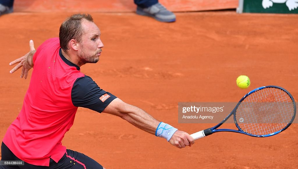 Steve Darcis of Belgium returns to Novak Djokovic (not seen) of Serbia during their men's single second round match at the French Open tennis tournament at Roland Garros in Paris, France on May 26, 2016.