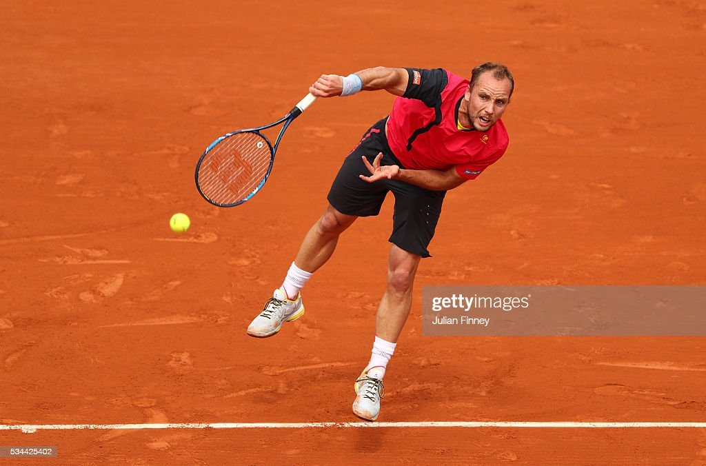 Steve Darcis of Belgium serves during the Men's Singles second round match against Novak Djokovic of Serbia on day five of the 2016 French Open at Roland Garros on May 26, 2016 in Paris, France.