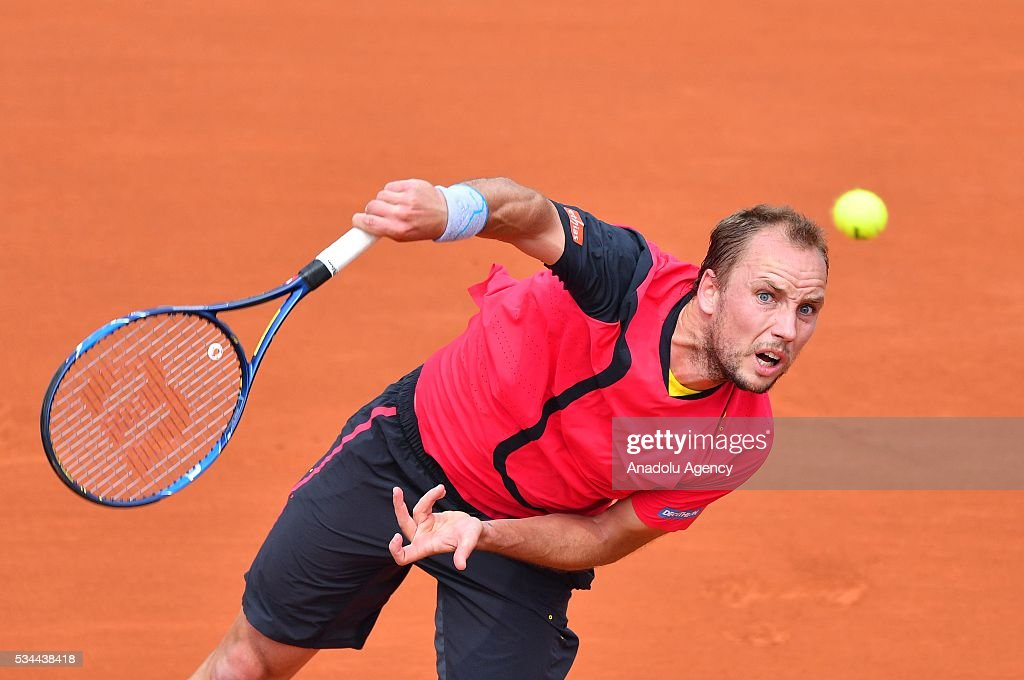 Steve Darcis of Belgium serves to Novak Djokovic (not seen) of Serbia during their men's single second round match at the French Open tennis tournament at Roland Garros in Paris, France on May 26, 2016.