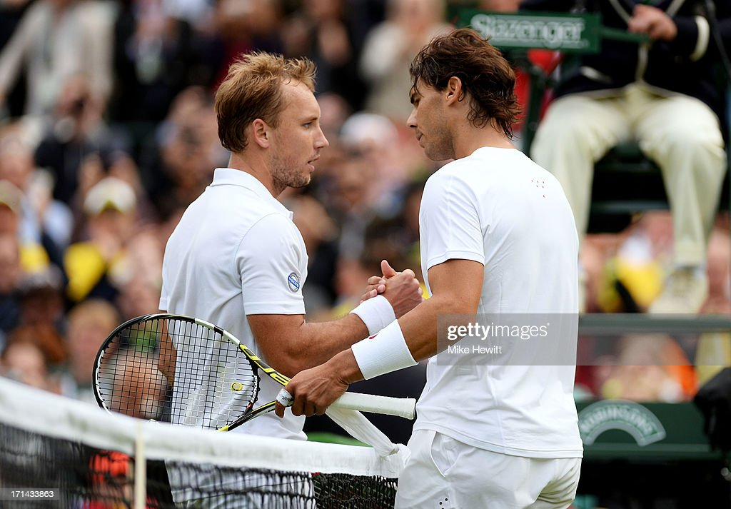 Steve Darcis of Belgium shakes hands at the net with Rafael Nadal of Spain after their Gentlemen's Singles first round match on day one of the Wimbledon Lawn Tennis Championships at the All England Lawn Tennis and Croquet Club on June 24, 2013 in London, England.