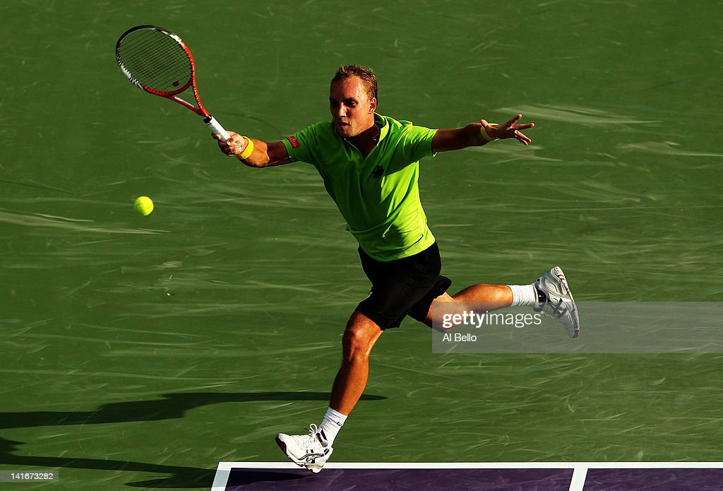 <a gi-track='captionPersonalityLinkClicked' href=/galleries/search?phrase=Steve+Darcis&family=editorial&specificpeople=4354952 ng-click='$event.stopPropagation()'>Steve Darcis</a> of Belguim in action against David Nalbandian of Argentina during Day 3 of the Sony Ericsson Open at Crandon Park Tennis Center on March 21, 2012 in Key Biscayne, Florida.