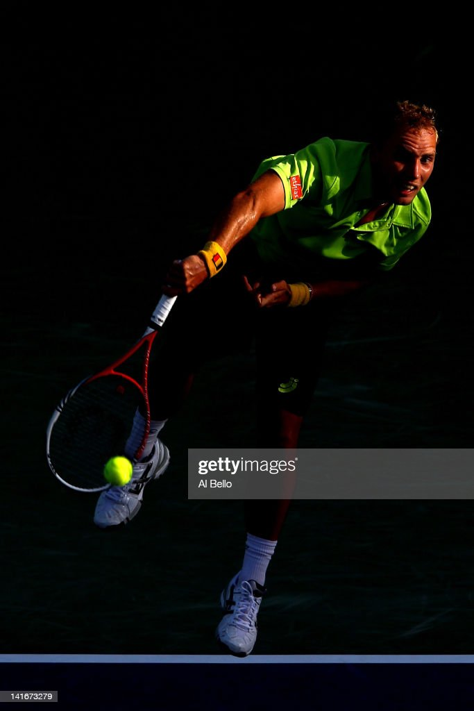 <a gi-track='captionPersonalityLinkClicked' href=/galleries/search?phrase=Steve+Darcis&family=editorial&specificpeople=4354952 ng-click='$event.stopPropagation()'>Steve Darcis</a> of Belguim serves to David Nalbandian of Argentina during Day 3 of the Sony Ericsson Open at Crandon Park Tennis Center on March 21, 2012 in Key Biscayne, Florida.