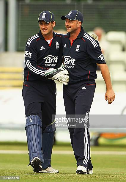 Steve Davies of England congratulates Darren Stevens on catching Manoj Tiwary of India during the One Day International match between England Lions...
