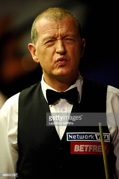 Steve Davis of England gestures in his match against John Higgins of Scotland during the Betfredcom World Snooker Championships at the Crucible...