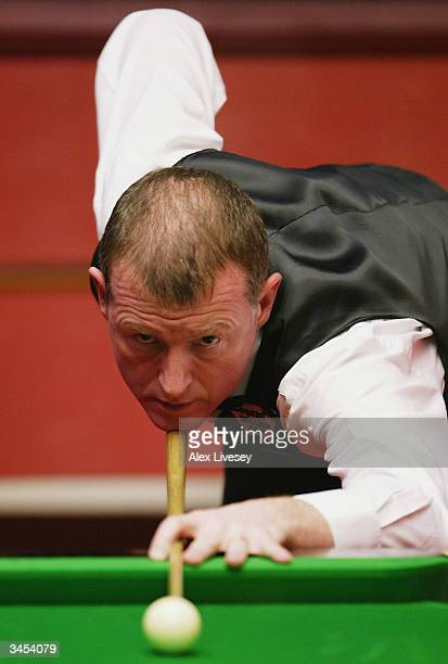 Steve Davis of England in action during his first round match against Anthony Hamilton of England in the Embassy World Snooker Championships held at...