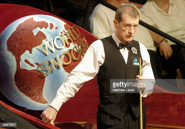Steve Davis of England looks on against Anthony Hamilton of England in the Embassy World Snooker Championships held at the Crucible Theatre on April...