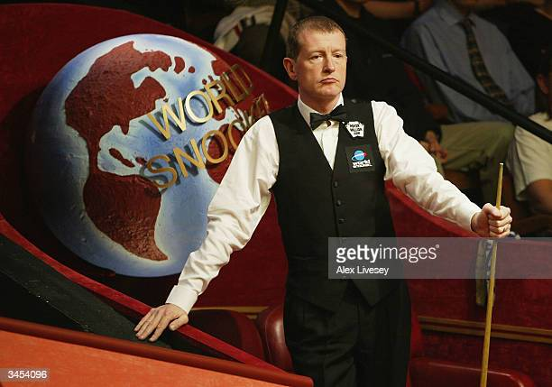 Steve Davis of England looks on during his first round match against Anthony Hamilton of England in the Embassy World Snooker Championships held at...
