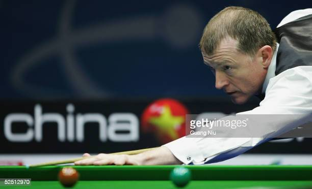 Steve Davis of England plays a ball during his match against against Ricky Walden of England on the fifth day of China Snooker Open on March 31 2005...