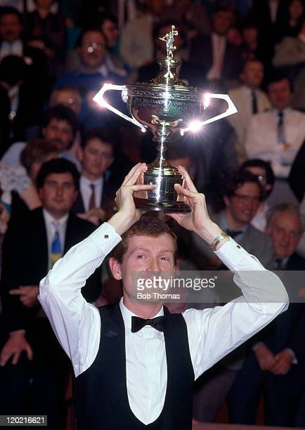Steve Davis of England World Snooker Champion after beating Terry Griffiths 1811 with the trophy at the Crucible in Sheffield circa May 1988
