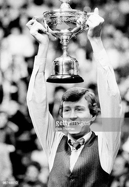 Steve Davis of Great Britain with the trophy after his victory over Cliff Thorburn in the World Professional Snooker Final at the Crucible Theatre in...
