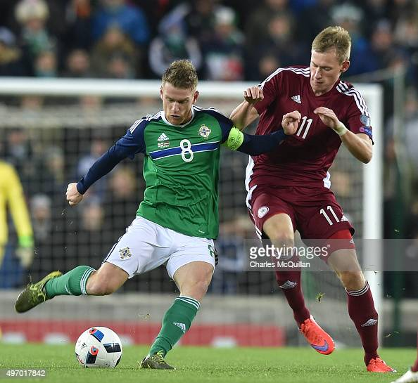 Steve Davis of Northern Ireland and Eduards Visnakovs of Latvia battle for the ball during the international football friendly match between Northern...