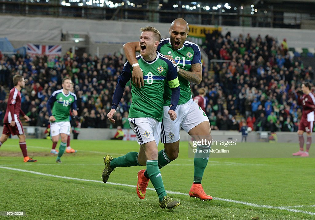 Steve Davis (L) of Northern Ireland celebrates with team mate Josh MaGennis (R) after scoring during the international football friendly match between Northern Ireland and Latvia at Windsor Park on November 13, 2015 in Belfast, Northern Ireland.