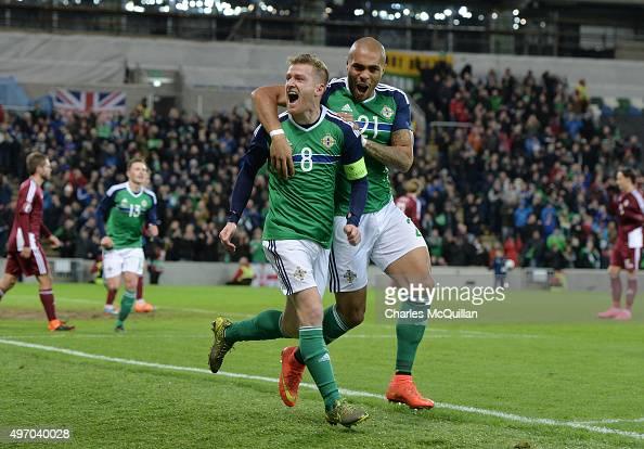 Steve Davis of Northern Ireland celebrates with team mate Josh MaGennis after scoring during the international football friendly match between...