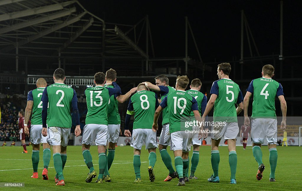 Steve Davis (5th L) of Northern Ireland celebrates with team mates after scoring during the international football friendly at Windsor Park on November 13, 2015 in Belfast, Northern Ireland.