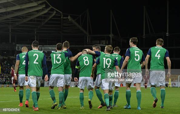 Steve Davis of Northern Ireland celebrates with team mates after scoring during the international football friendly at Windsor Park on November 13...