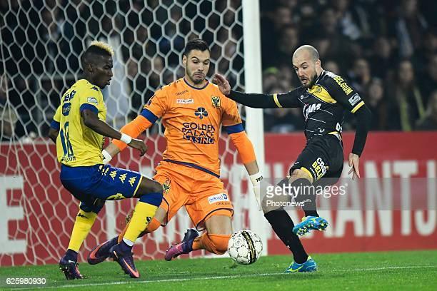 Steve De Ridder forward of Sporting Lokeren missing an opportunity in front of Lucas Pirard goalkeeper of STVV and Mamadou Bagayoko defender of STVV...