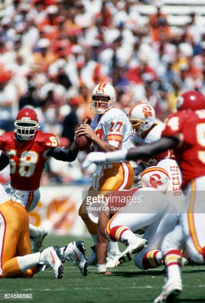 Steve DeBerg of the Tampa Bay Buccaneers drops back to pass against the Kansas City Chiefs during an NFL football game October 26 1986 at Arrowhead...