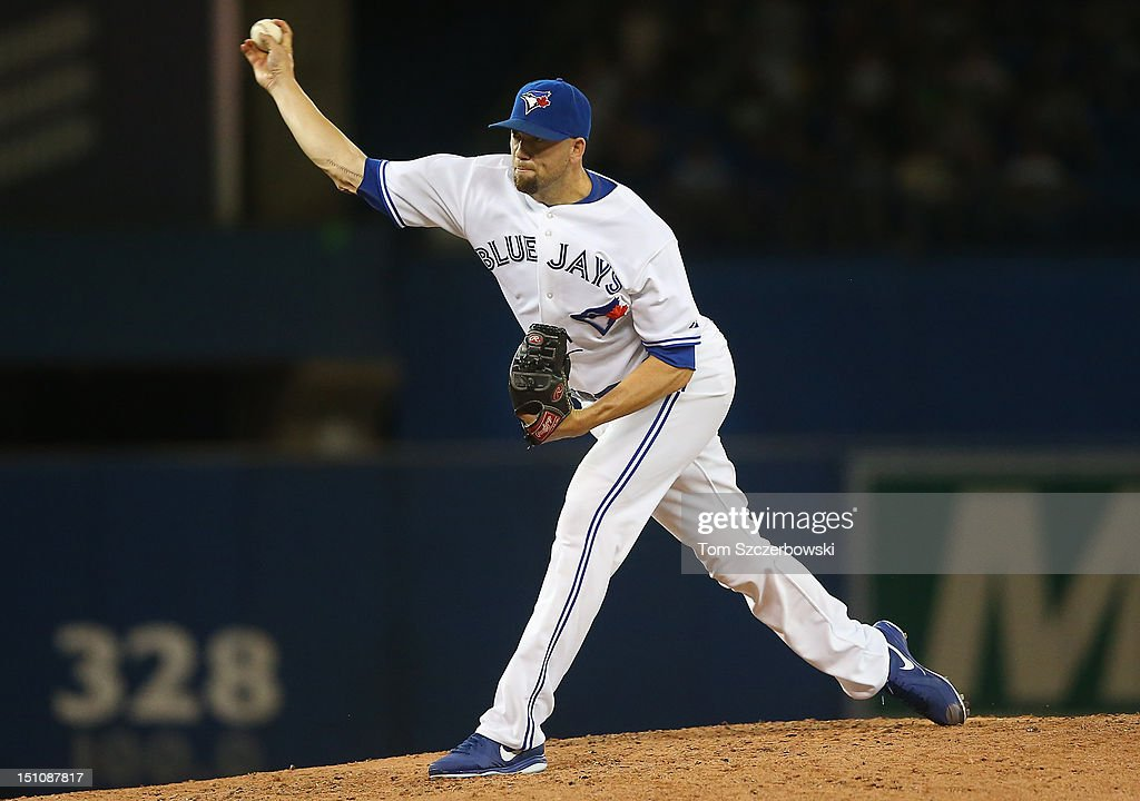 Steve Delabar #50 of the Toronto Blue Jays delivers a pitch during MLB game action against the Tampa Bay Rays on August 31, 2012 at Rogers Centre in Toronto, Ontario, Canada.