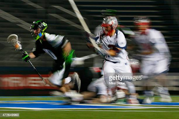 Steve DeNapoli of the New York Lizards carries the ball against the Boston Cannons at James M Shuart Stadium on May 8 2015 in Hempstead New York