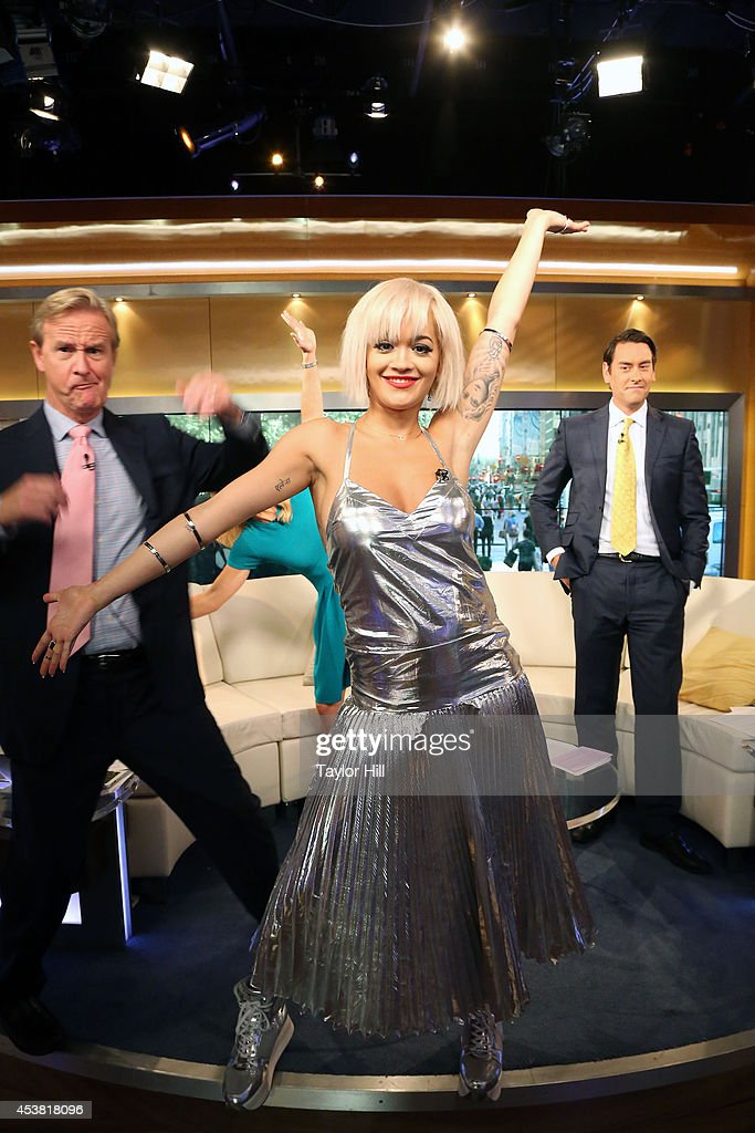 Steve Doocy and Clayton Morris photobomb Rita Ora as she visits 'Fox & Friends' at the FOX Studios on August 19, 2014 in New York City.