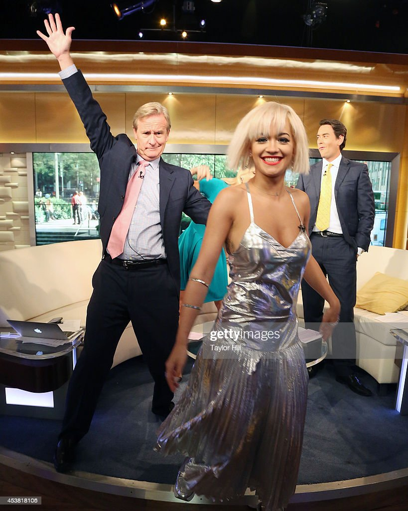 Steve Doocy, Elisabeth Hasselbeck, and Clayton Morris photobomb Rita Ora as she visits 'Fox & Friends' at the FOX Studios on August 19, 2014 in New York City.