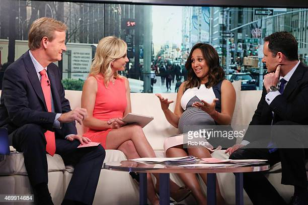 Steve Doocy Elisabeth Hasselbeck guest Tamera Mowry and Brian Kilmeade appear on 'FOX Friends' at FOX Studios on April 16 2015 in New York City
