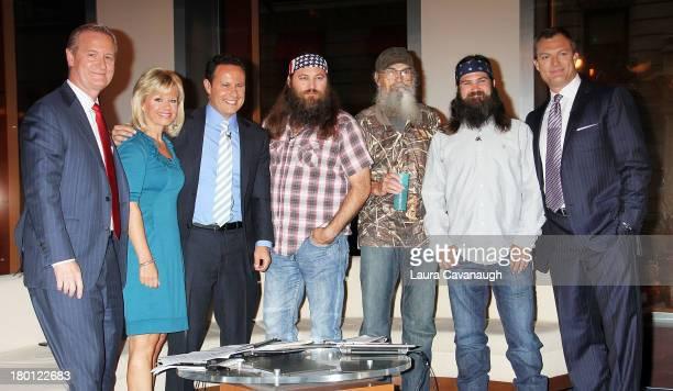 Steve Doocy Gretchen Carlson Brian Kilmeade John Lynch and The cast of 'Duck Dynasty' Si Robertson Jep Robertson and Willie Robertson visit 'Fox And...