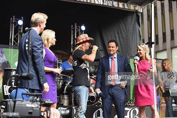 Steve Doocy Heather Nauert singer Bret Michaels Brian Kilmeade and Elisabeth Hasselbeck seen on stage at 'FOX Friends' All American Concert Series...