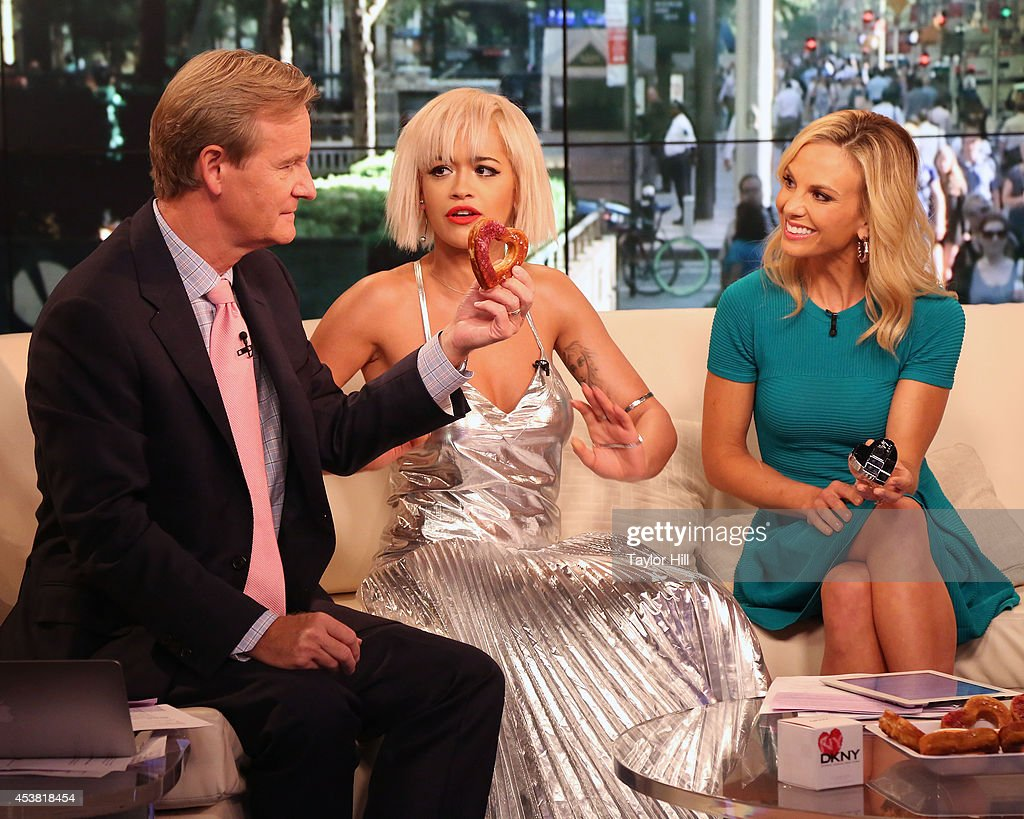 Steve Doocy, Rita Ora, and Elisabeth Hasselbeck chat as Rita Ora visits 'Fox & Friends' at the FOX Studios on August 19, 2014 in New York City.