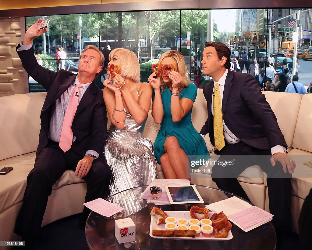 Steve Doocy, Rita Ora, Elisabeth Hasselbeck, and Clayton Morris have fun with heart-shaped cronuts from Dominique Ansel Bakery as she visits 'Fox & Friends' at the FOX Studios on August 19, 2014 in New York City.
