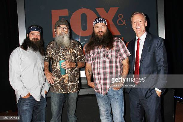 Steve Doocy with The cast of 'Duck Dynasty' Si Robertson Jep Robertson and Willie Robertson visit 'Fox And Friends' at Fox News Studios on September...