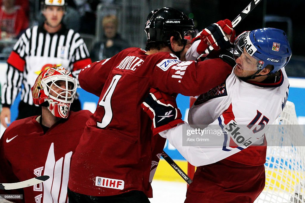 Steve Downie (L) of Canada fights with Jan Marek of Czech Republic during the IIHF World Championship group F qualification round match between Canada and Czech Republic at SAP Arena on May 18, 2010 in Mannheim, Germany.
