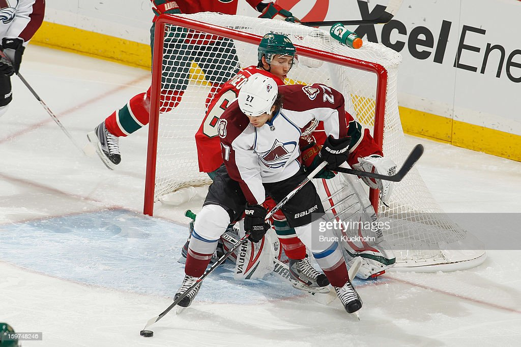 <a gi-track='captionPersonalityLinkClicked' href=/galleries/search?phrase=Steve+Downie&family=editorial&specificpeople=714514 ng-click='$event.stopPropagation()'>Steve Downie</a> #27 of the Colorado Avalanche handles the puck while Jared Spurgeon #46 and goalie Niklas Backstrom #32 defend on January 19, 2013 at the Xcel Energy Center in Saint Paul, Minnesota.