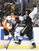 Steve Downie of the Philadelphia Flyers and Tanner Glass of the Pittsburgh Penguins collide during the game at Consol Energy Center on November 13...