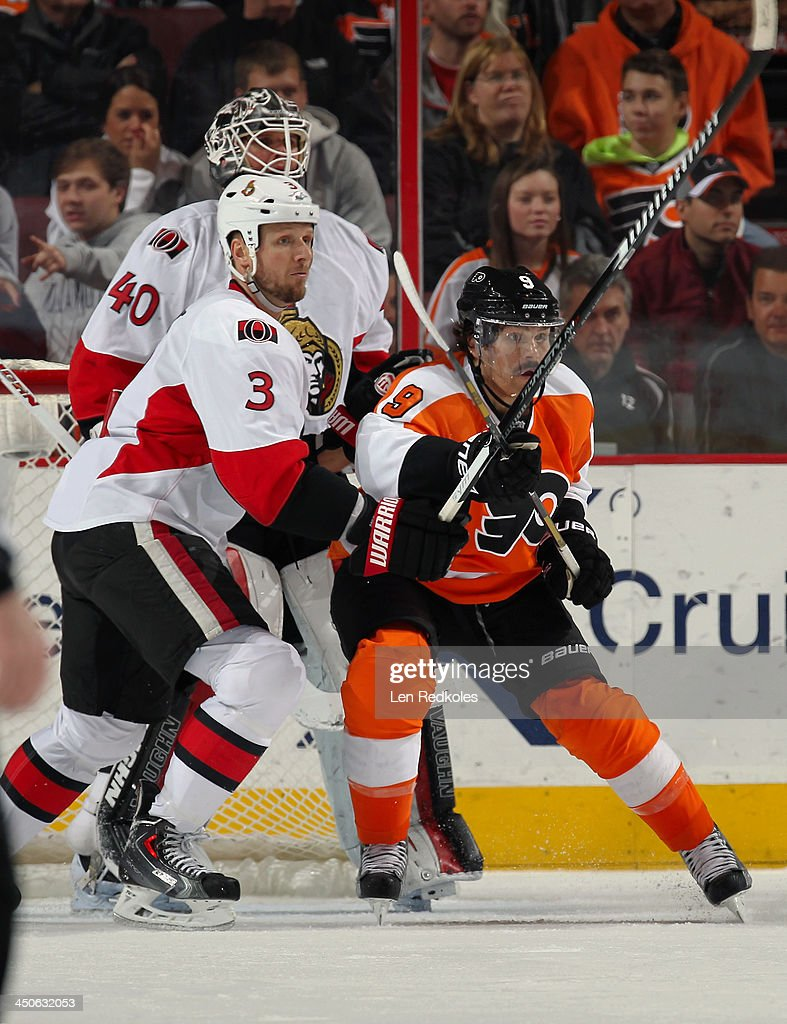 Steve Downie #9 of the Philadelphia Flyers battles in front of goaltender Robin Lehner #40 of the Ottawa Senators with Mark Methot #3 on November 19, 2013 at the Wells Fargo Center in Philadelphia, Pennsylvania.