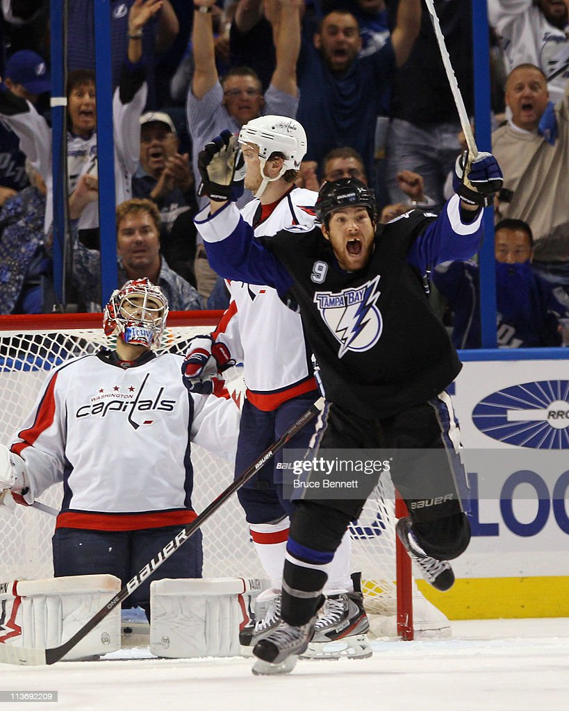 <a gi-track='captionPersonalityLinkClicked' href=/galleries/search?phrase=Steve+Downie&family=editorial&specificpeople=714514 ng-click='$event.stopPropagation()'>Steve Downie</a> #9 of the Tampa Bay Lightning celebrates the game winning goal by Marc-Andre Bergeron #47 at 5:07 of the third period against the Washington Capitals in Game Four of the Eastern Conference Semifinals during the 2011 NHL Stanley Cup Playoffs at the St Pete Times Forum on May 4, 2011 in Tampa, Florida. The Lightning defeated the Capitals 5-3 and swept the series 4 games to none.