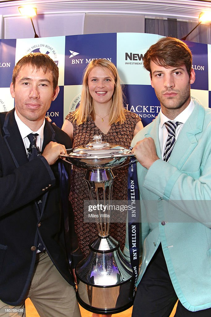 Steve Dudek, President of the Cambridge University Boat Club, <a gi-track='captionPersonalityLinkClicked' href=/galleries/search?phrase=Anna+Watkins&family=editorial&specificpeople=7026388 ng-click='$event.stopPropagation()'>Anna Watkins</a> Olympic Gold medalist and BNY Mellon Ambassador and <a gi-track='captionPersonalityLinkClicked' href=/galleries/search?phrase=Malcolm+Howard&family=editorial&specificpeople=2969427 ng-click='$event.stopPropagation()'>Malcolm Howard</a>, President of the Oxford University Boat Club pose with The Boat Race Trophy during the BNY Melon University Boat Race Autumn Reception at the BNY Melon offices on 24th October 2013 in London, England.