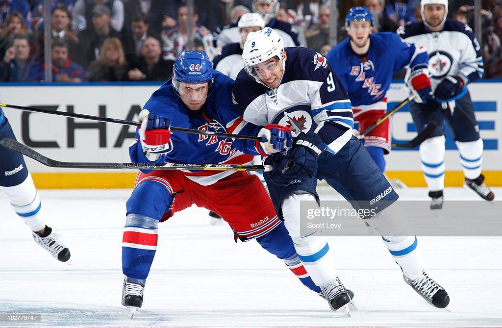 Steve Eminger of the New York Rangers battles with Evander Kane of the Winnipeg Jets at Madison Square Garden on February 26 2013 in New York City
