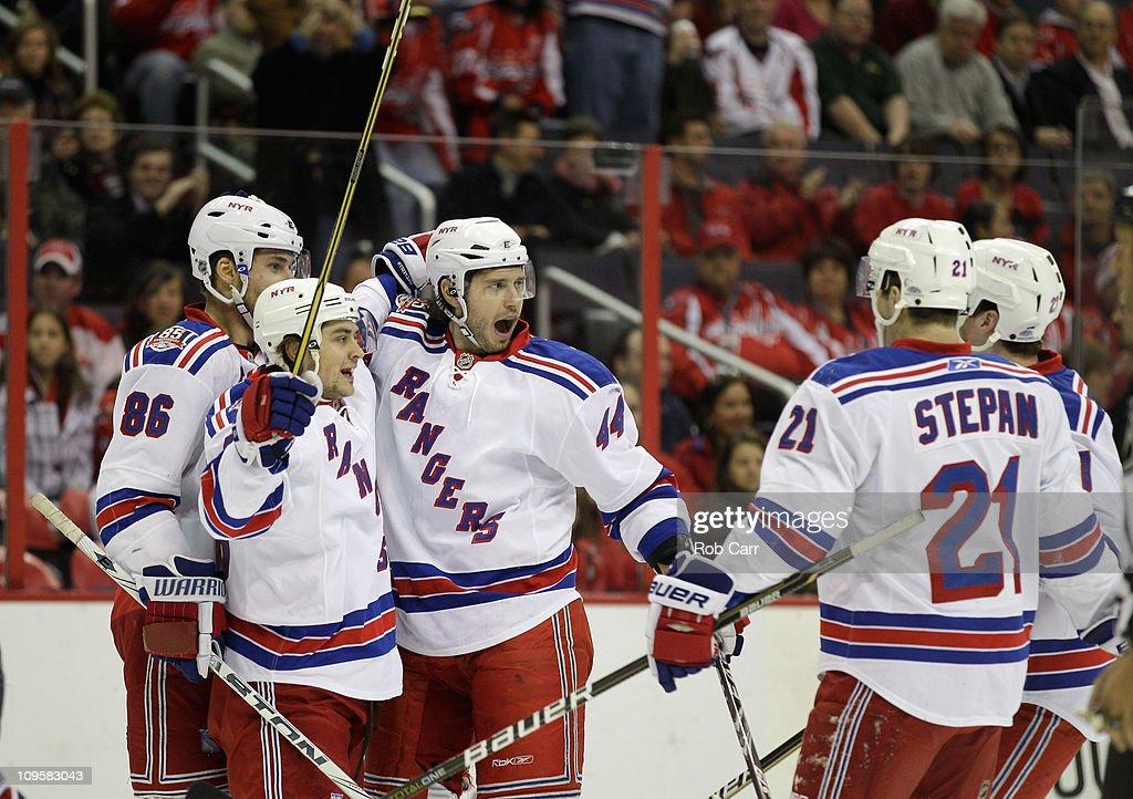 Steve Eminger of the New York Rangers celebrates his goal against the Washington Capitals with teammates Wojtek Wolski and Mats Zuccarello at the...