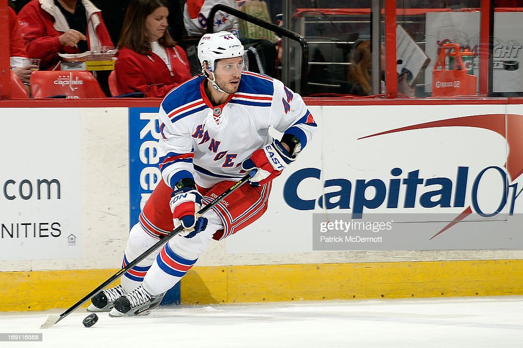 Steve Eminger of the New York Rangers controls the puck in Game Seven of the Eastern Conference Quarterfinals during the 2013 NHL Stanley Cup...