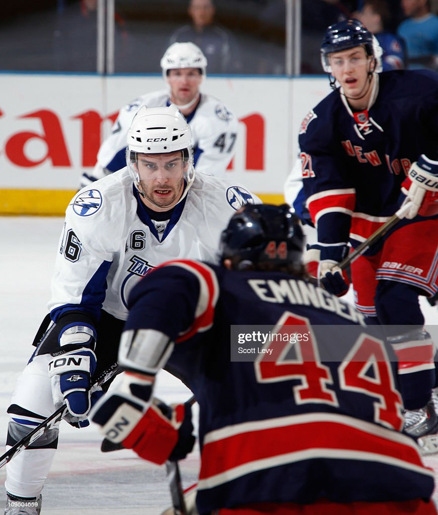 Steve Eminger of the New York Rangers defends against Teddy Purcell of the Tampa Bay Lightning on February 27 2011 at Madison Square Garden in New...