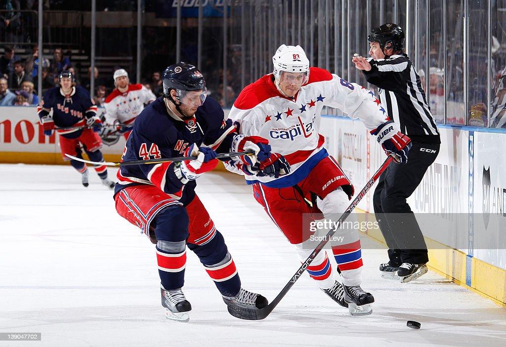 Steve Eminger of the New York Rangers skates against Jay Beagle of the Washington Capitals at Madison Square Garden on February 12 2012 in New York...