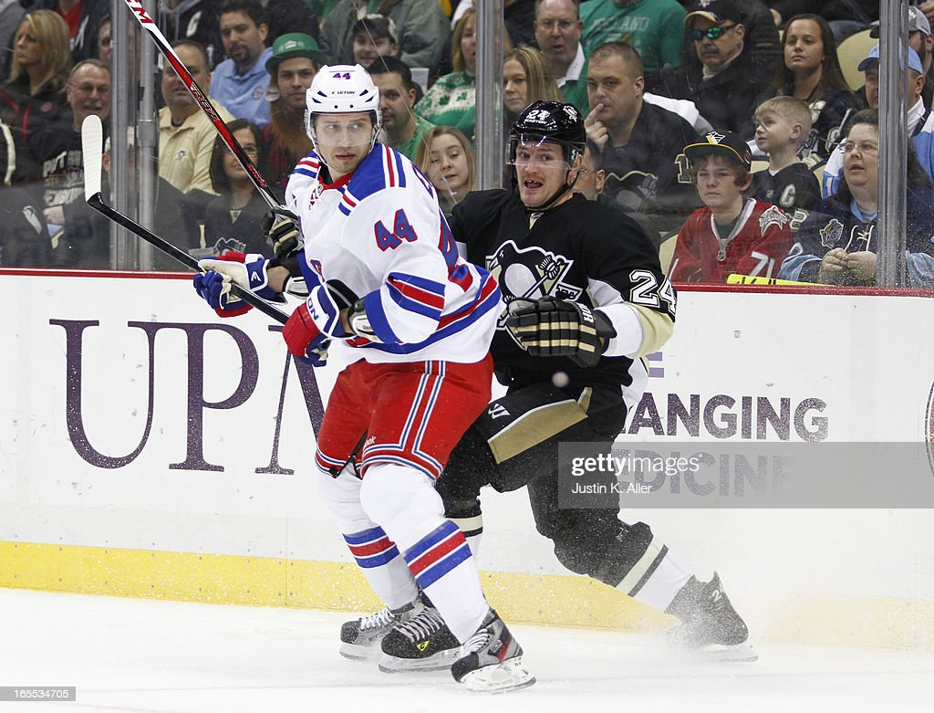 Steve Eminger of the New York Rangers skates against Matt Cooke of the Pittsburgh Penguins during the game at Consol Energy Center on March 16 2013...
